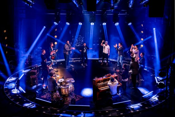 """The cast of """"The Choir of Man"""" reunite in London's historic West End Garrick Theatre for a special """"EMBARK NCL Spotlight Series"""" performance."""
